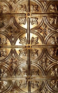 antique tin tile with bronze hue