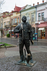 Mukachevo, Ukraine - April 6, 2015: Monument of Happy Chimney Sweeper and his cat. The monument with real chimney sweeper Bertalon Tovt by Ukrainian sculptor Ivan Brovdi.