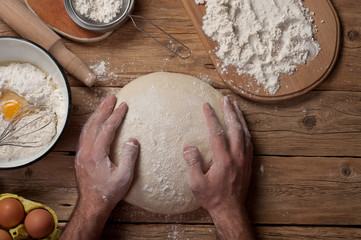 Fototapete - Male baker prepares bread