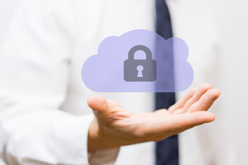 Businessman holding protected cloud, concept of  business cloud