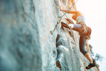Rock climbing on vertical flat wall - Stock image