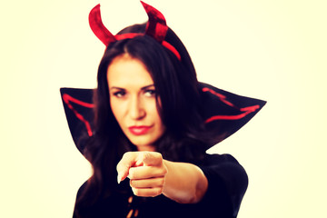 Woman in devil clothes pointing on you