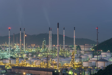 Oil refinery and storage tanks at twilight