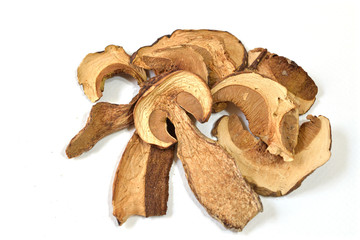 Dried porcini mushrooms on white background