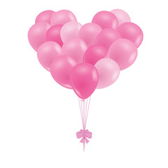 A bunch of balloons. Pink balloons in the shape of a heart.