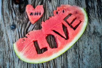 Fresh juicy watermelon slice  close-up with love letters word