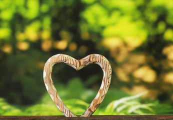 Wooden heart symbol on a gray background