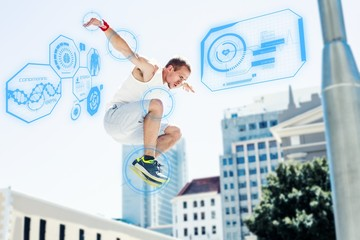 Composite image of man doing parkour in the city