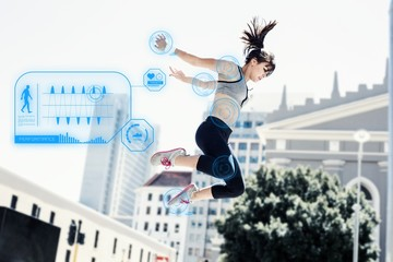Composite image of woman doing parkour in the city
