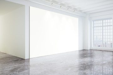 Blank poster in light modern loft gallery with big windows and c
