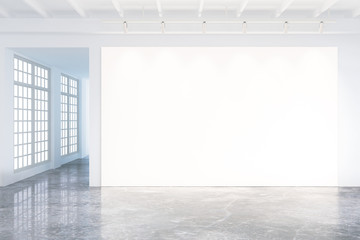 Mock up of blank poster in modern loft interior with big windows
