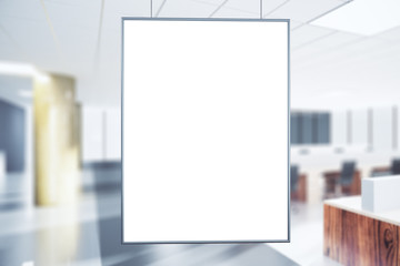 Blank white poster in the office at sunrise, mock up