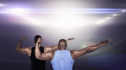 Composite image of strong friends posing with arms out