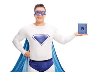 Superhero holding a small blue safe