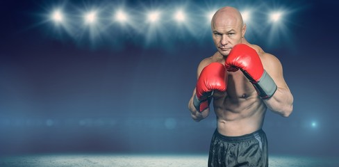 Composite image of portrait of boxer with gloves