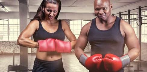Male and female boxers with gloves