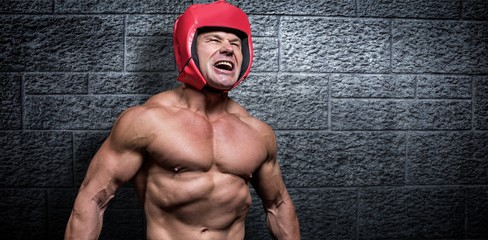 Composite image of angry boxer with headgear