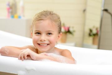 Pretty little girl taking bath