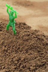 toy soldier in soil