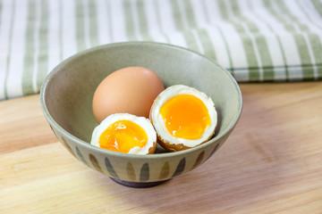 half medium-boiled eggs in Japanese Bowl