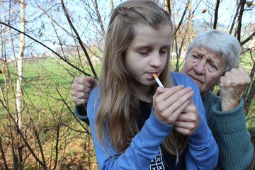 teenager smoking, grandmother trying to stop her