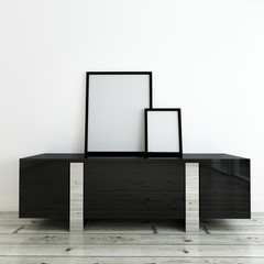 Picture Frames on Desk in Room with White Wall