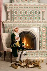 Boy in vintage costume near the fireplace