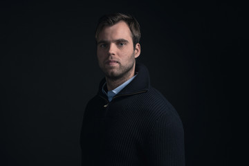 Fashionable man wearing dark blue winter sweater with light blue
