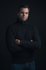 Winter fashion man wearing dark blue turtleneck.