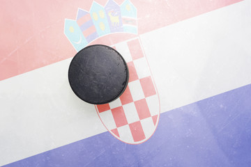 old hockey puck is on the ice with croatia flag