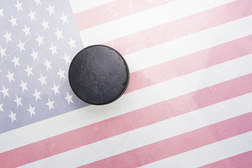 old hockey puck is on the ice with united states of america flag