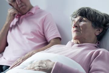 Man assisting woman at hospital