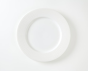 White porcelain plate with wide rim