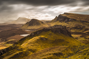 Wall Mural - Dark clouds and beautiful colors over the Quiraing on the Isle of Skye in Scotland - UK
