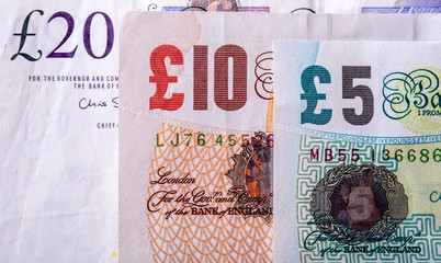 Pound currency, money, banknote.  English currency. UK banknotes of different values stacked on each other.