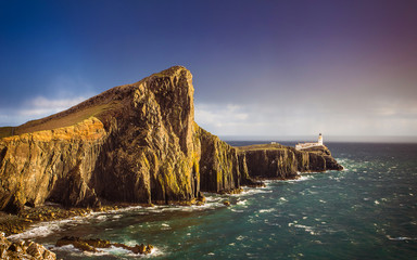 Wall Mural - The famous Neist Point Lighthouse minutes before a heavy strom on the Isle of Skye - Scotland, UK