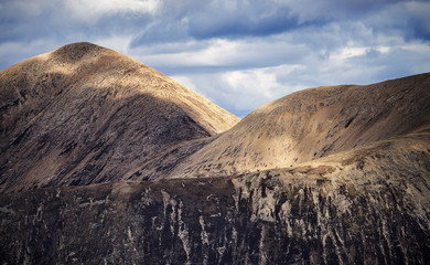 Wall Mural - The Scottish Highlands. Detailed photo of the Cuillin mountains on a cloudy day - Isle of Skye, Scotland, UK