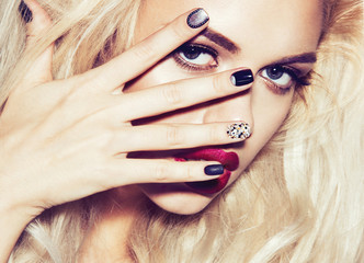 Beautiful sexy blonde girl with sensual lips, fashion hair, black art nails.Instagram filters. Beauty face.