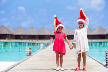 Little adorable girls during Christmas beach vacation