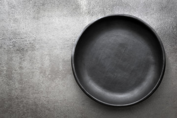 Empty Rustic Black Plate over Slate