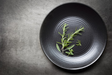 Herbs on Black Plate over Slate Aerial view