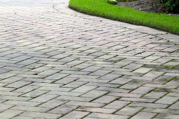 edge of curved paved driveway