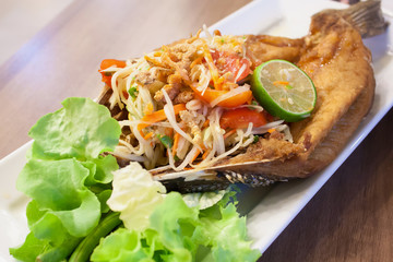 papaya salad with fried fish Thai cuisine spicy delicious