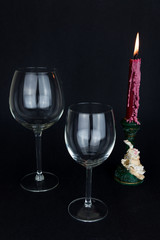 wine glass and candle on black background