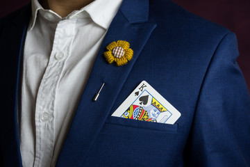 man in blue suit with king spades