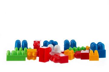 Plastic toy blocks isolated on white background