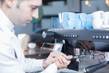 Side view of bartender making coffee