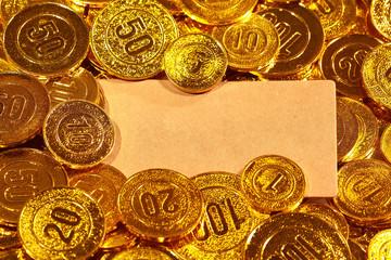 Kraft paper postcard in gold coins heap