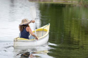woman rowing in a canoe
