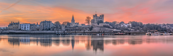Rochester, United Kingdom - March 12, 2015: Dawn over Rochester. Early morning picture with medieval structures, sunrise and reflection on river.